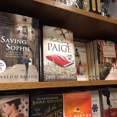 Jewish Book Concil Writers Conference, Protecting Paige on book shelf